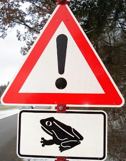 Warning sign: beware of frogs