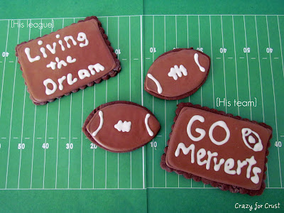 chocolate sugar cookies with royal icing on top on green football field paper
