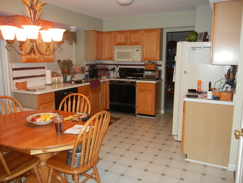 Honey Cabinets, Laminate Floor, Neo Traditional Dining Table, Odd Layout.  Yup, Definitely A 90s Kitchen.