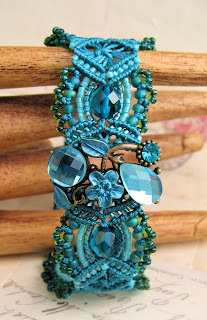 Bracelet by Sherri Stokey of KnotJust Macrame with a slider featuring teal crystals and flowers.