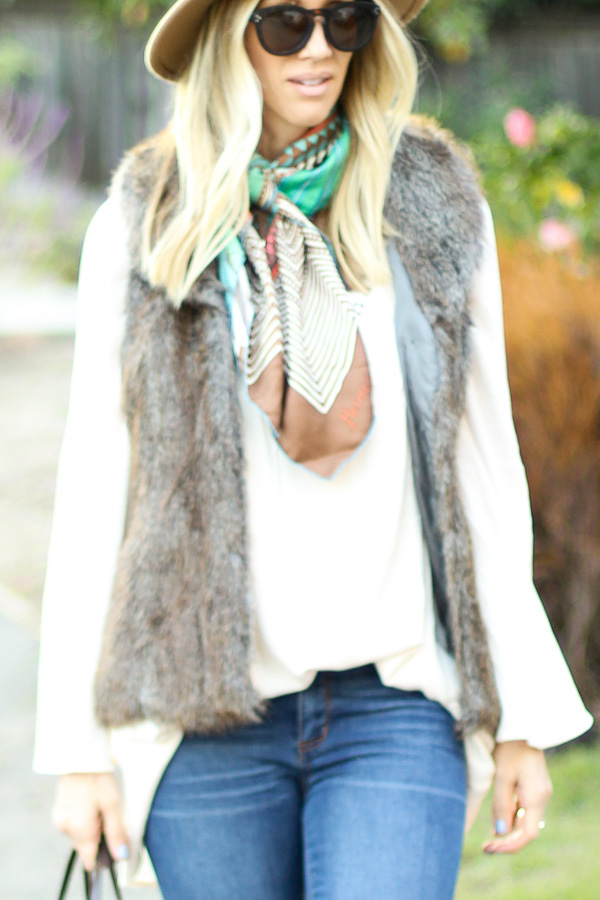 brown faux fur vest layered over top