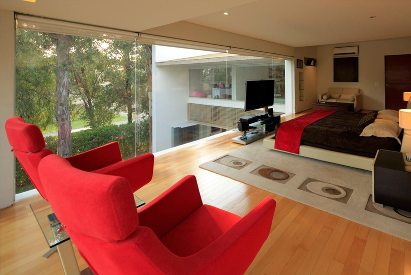 Glass wall in the bedroom if Godoy House by Hernandez Silva Arquitectos in Mexico
