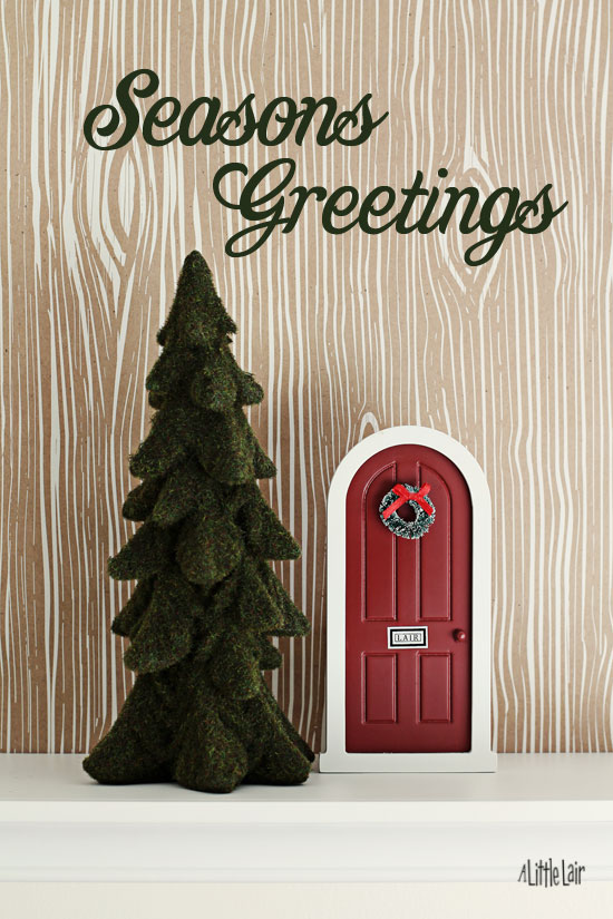 Add a holiday wreath to your elf door. | Everyday Magic