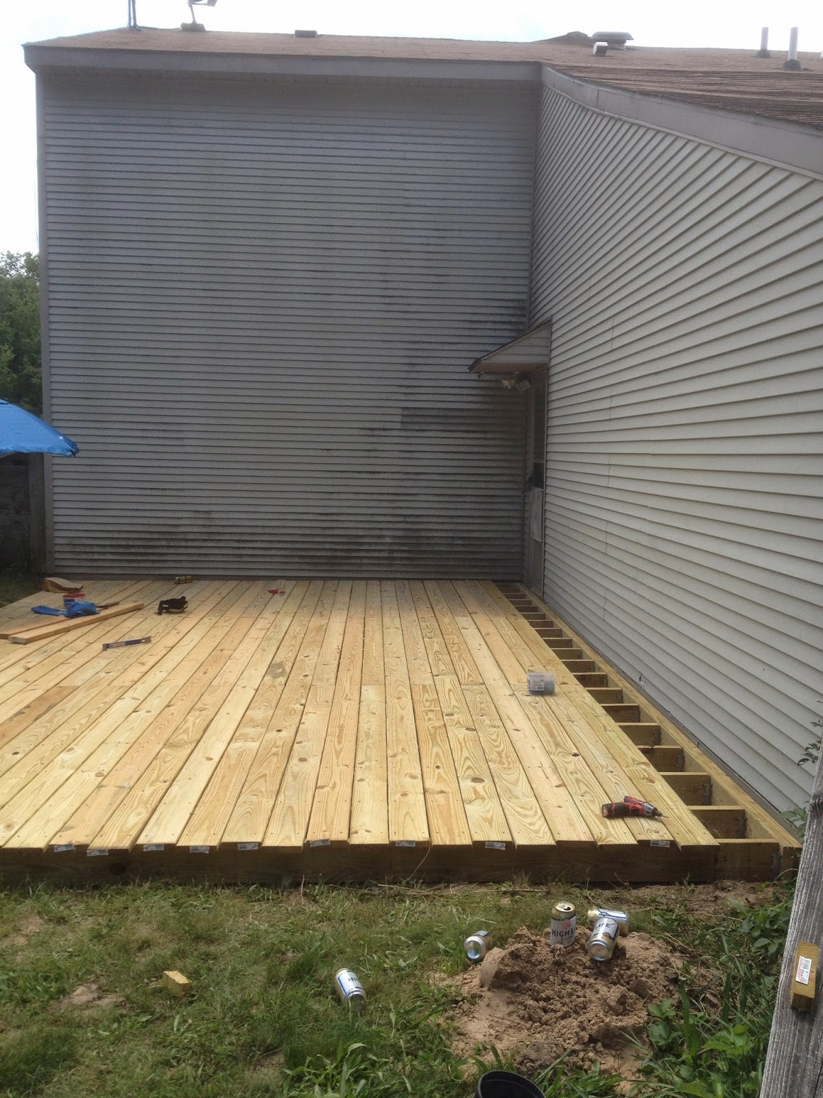 From dirt to deck how to build a ground level deck the for 12x12 roll up garage door