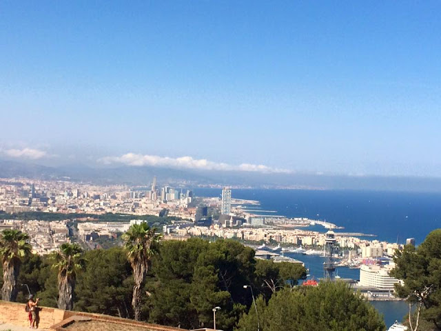 preppy blogger travel barcelona montjuic cable car view of barceloneta