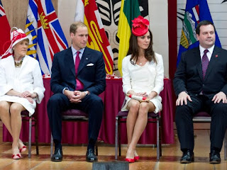William and Kate, the Duke and Duchess of Cambridge, flanked by Sharon Johnston, wife of Governor General David Johnston and Immigration Minister Jason Kenney, listen to proceedings during a citizenship ceremony on Friday, July 1, 2011, in Gatineau, Canada.