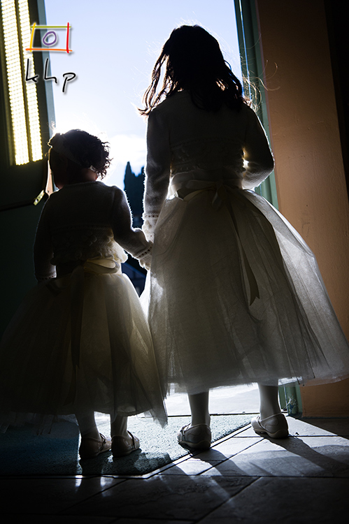 The backlight adds an incredibly dramatic ambiance to this photograph of the two flower girls.