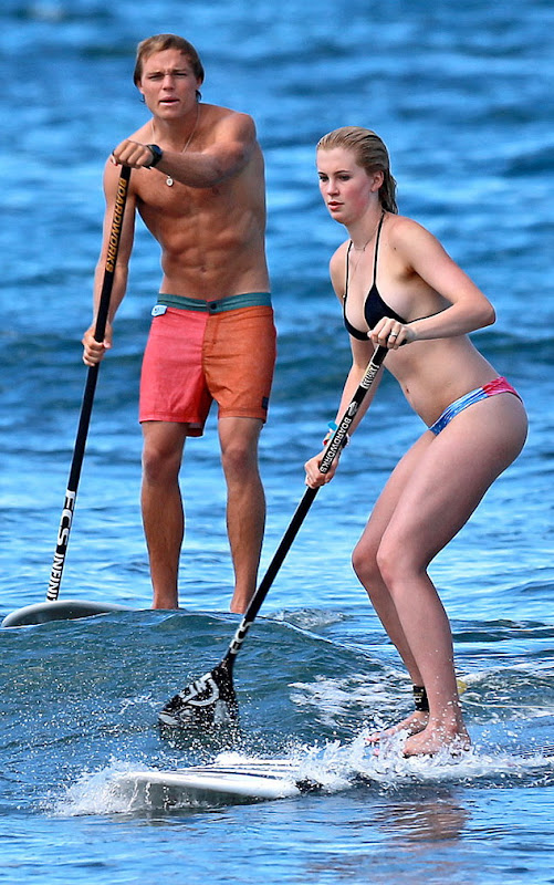 Ireland Baldwin paddle boarding with boyfriend
