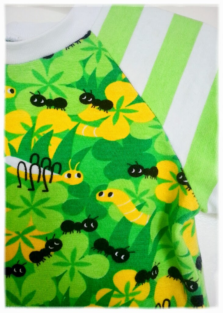 gröna tyger myror blommor