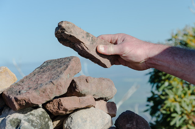 placing rock on durd-durd summit cairn