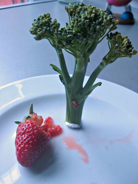 Murderous Broccoli eating a strawberry victim