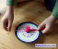Handmade humming top toys from CD boxes