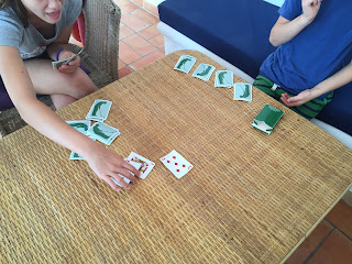 Two children playing cards