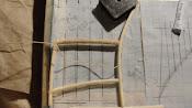 Rieten ligstoel maken.