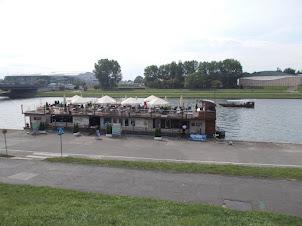 Boat restaurant on Vistula river flowing through Krakow City.