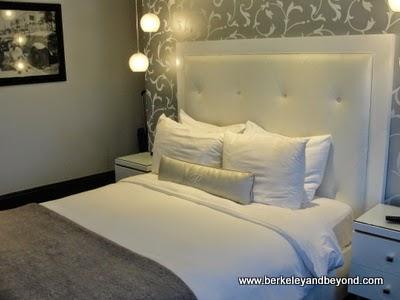 bed in La Pensione Hotel in Little Italy, San Diego, California