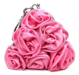 A cute pink rosette clutch purse.