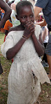 Girl in Uganda~upon hearing she is about to receive a new dress!