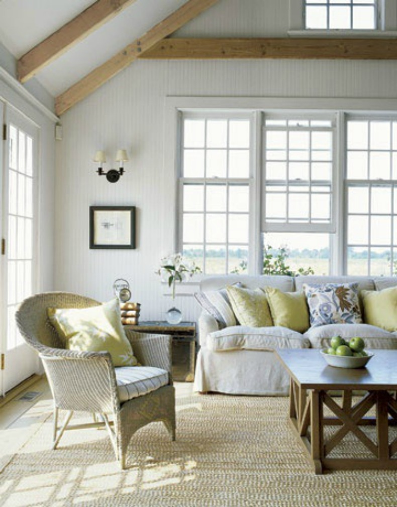 Coastal white slipcover sofa in living room with ocean view