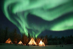 Northern Lights Over Teepees,  NORTHERN LIGHTS, YELLOW KNIFE. CANADA