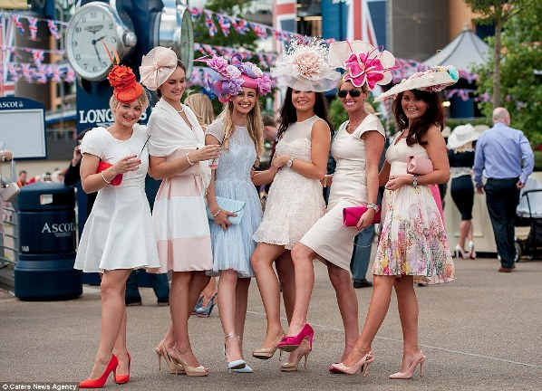 stylish racegoers in nude and cream dresses and floral hats on day 2 Royal Ascot 2014