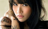 Ploy Chermarn is a beautiful Thai woman.