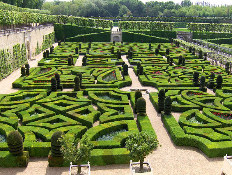 Green animal garden topiary art for Jardin geometrico