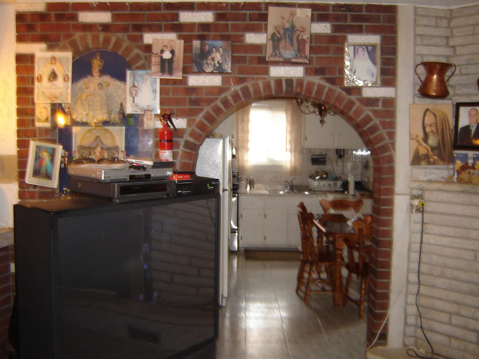 The fireplace and brick wall were added in the early 1980s. The  title=