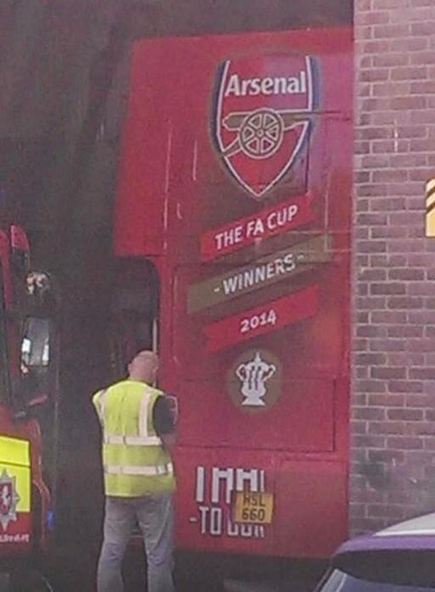 'The FA cup winners 2014' prematurely emblazoned on rear of team bus.