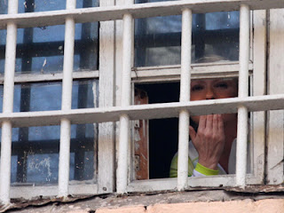 Фото Укринформ:Юлия Тимошенко за решеткой
