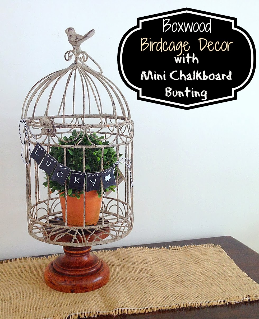 http://www.twoityourself.com/2014/02/boxwood-bird-cage-with-mini-chalkboard.html