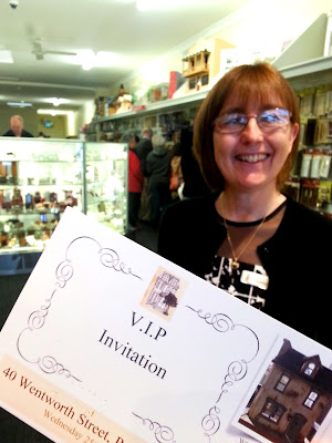 Owner of Fairy Meadow Miniatures with a VIP opening invitation.
