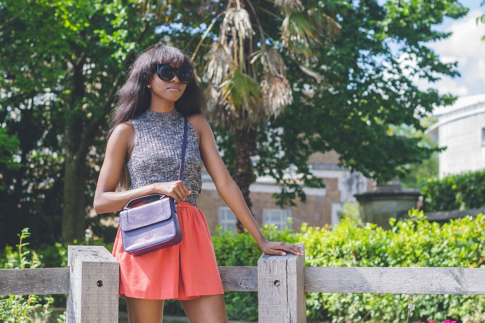 Oroma Roxella Rukevwe wearing Osprey London Bag