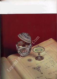 Below, the Mosaic Egg presented to the Tsarina, Alexandra Feodorovna, by Nicholas 11 on Easter morning 1914. Shown resting on the page of the Faberge record books next to the watercolor drawing by Alma Theresia Pill!, dated 24 July 1913, from which the Imperial Egg derives. Reproduced by Gracious Permission of Her Majesty Queen Elizabeth II