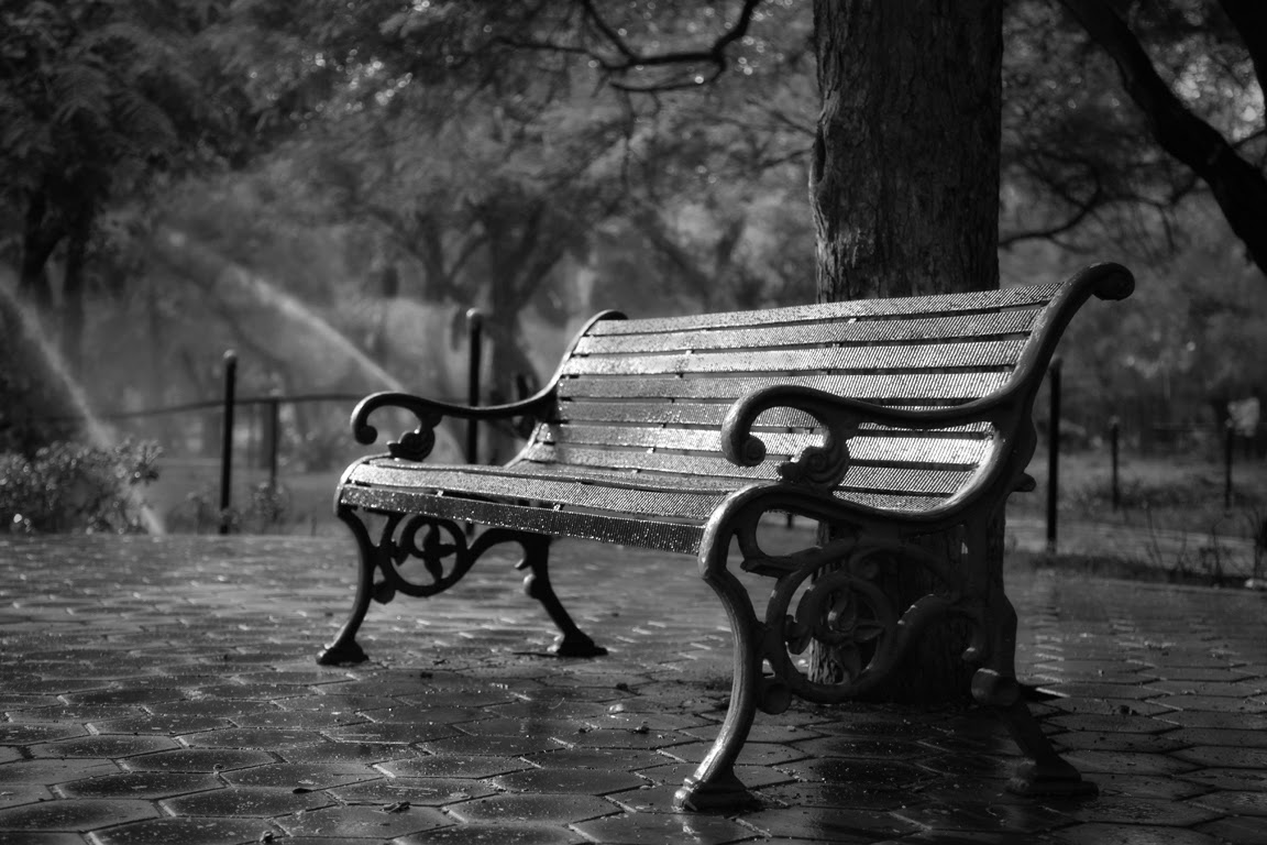 """Just Sit Back and Relax!"" by Vinoth Chandar; Chair bench, black and white, earlier morning, very peaceful and still."