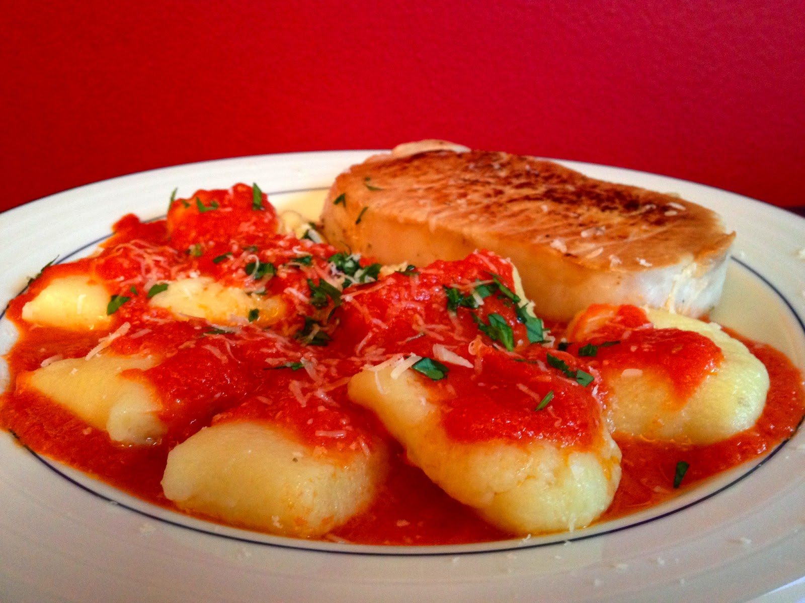 Marcella Hazan's Potato Gnocchi with Tomato Sauce served with a simple ...