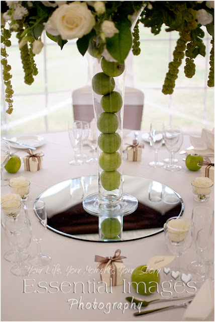 Green apples in the stem of the flower vase for wedding