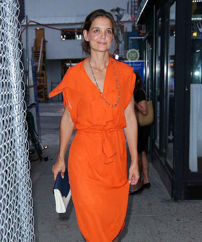 Katie Holmes wearing an orange dress