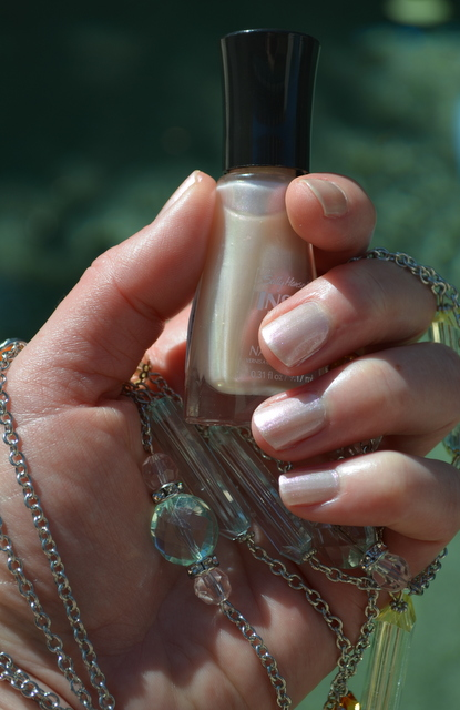 In a flash nail polish, Sally Hansen & Necklace by Charming Charlie