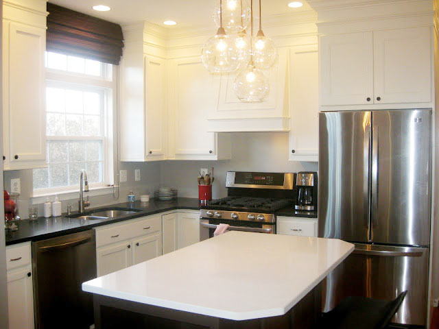 kitchen cabinets painted Benjamin Moore Aura - Satin - Navajo White and Tudor Brown