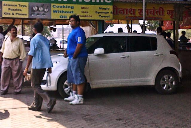 fat boy near car