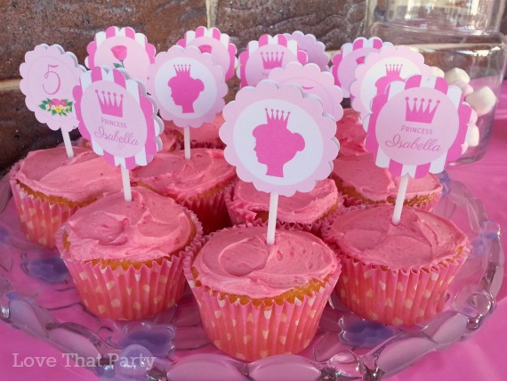 Image of pink cupcake with personalised cupcake toppers for princess party