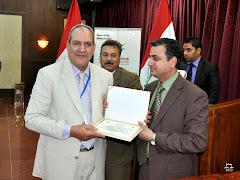 فى فندق المنصور ميليا ببغداد متسلما شهادة تكريم من وزارة الثقافة العراقية ببغداد 2012