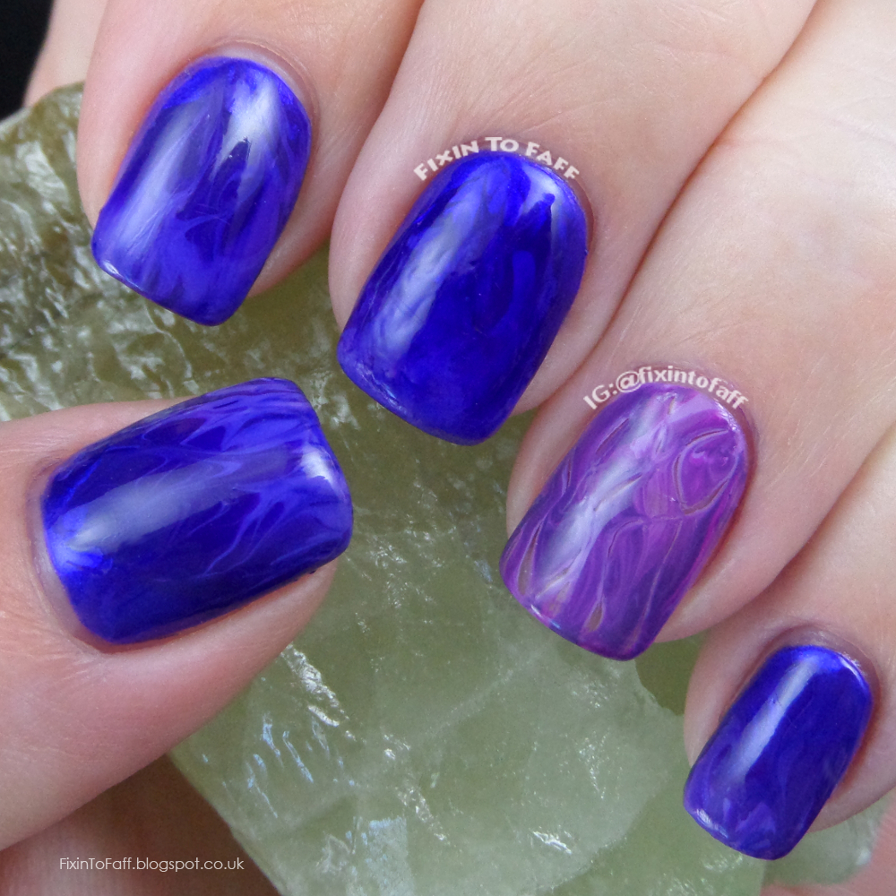 Purple flame pin-drag marble nail art.