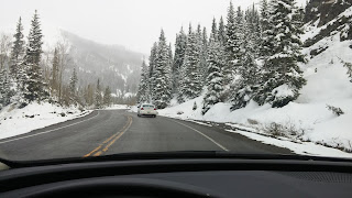 driving on the snow-capped Million Dollar Highway in May from Telluride to Durango Colorado