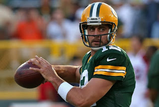 Aaron Rodgers attempting to throw a pass