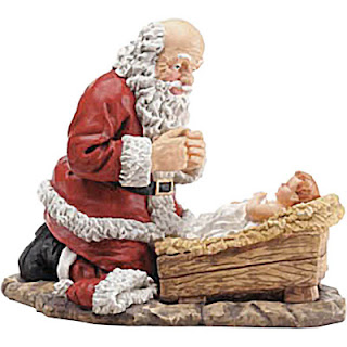 Santa bowing and praying to child Jesus Christ stable craft photo