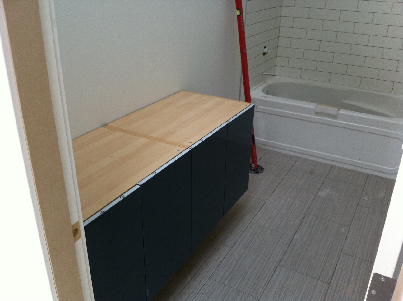 Floating ikea vanity and basement vanity.  The Mt. Pleasant Houses