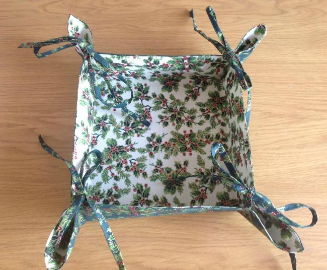 finished Christmas gift basket white fabric inside