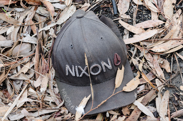 hat lying on the ground with motif nixon